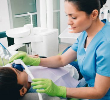 dental hygienist with a patient