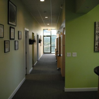 Hallway with pictures on the wall and operatories